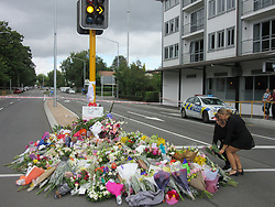 March 16, 2019 - Christchurch, New Zealand - People bring flowers to Deans Avenue and to the Al Nour mosque in memory of the victims. (Credit Image: © Russian Look via ZUMA Wire)
