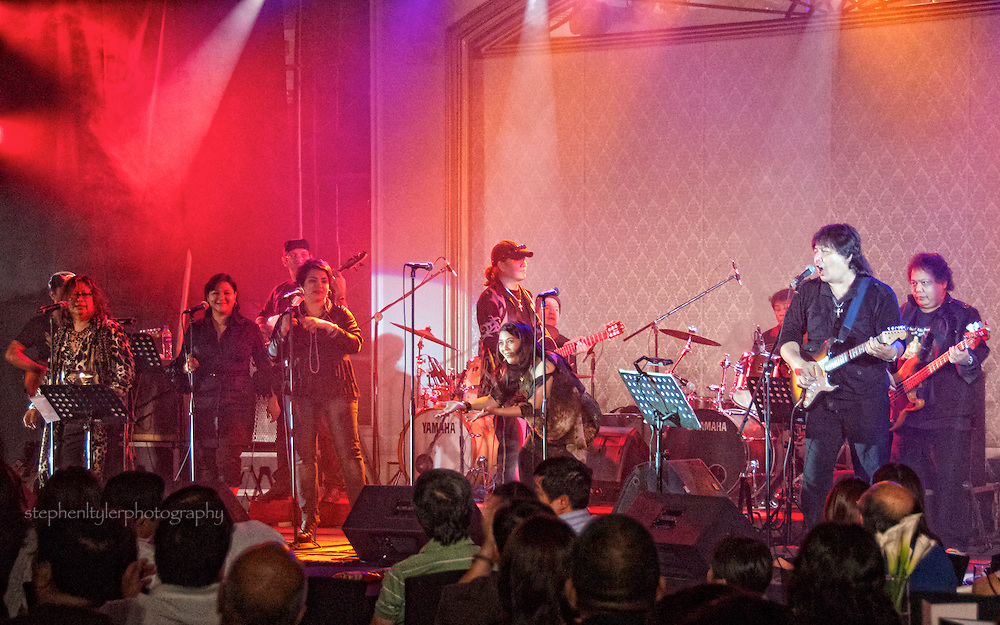 Dennis and Rene Garcia lead The Hot Dog Band for an evening of reminiscence of seventies style original Pinoy music for their fans in the Dusit Hotel Ballroom in Manila, Philippines on May 16, 2011.