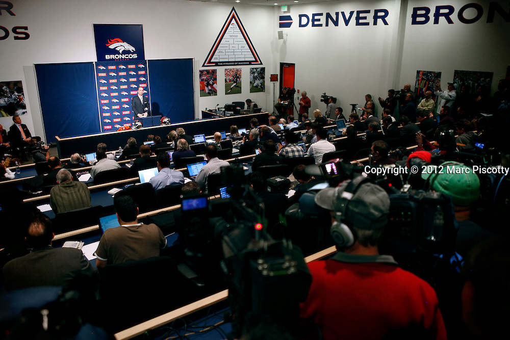 SHOT 3/20/12 1:27:56 PM - The Denver Broncos introduced free agent quarterback Peyton Manning to a very crowded media gathering at team headquarters in Englewood, Co. at a press conference on Tuesday Marc 20, 2012. Manning is coming off neck surgery and was released by the Indianapolis Colts. He signed a five year, $96 million contract with the Broncos..(Photo by Marc Piscotty / © 2012)