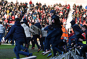 A pitch invasion by Doncaster fans takes place after John Marquis' goal during the EFL Sky Bet League 1 match between Doncaster Rovers and Coventry City at the Keepmoat Stadium, Doncaster, England on 4 May 2019.