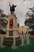 Christopher Columbus statue and Cathedral of Nuestra Senora de la Candelaria in Plaza Colon, Mayaguez Puerto Rico