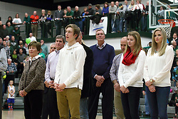 21 February 2015: Dennie Bridges family watches from the court. At half time of an NCAA D# CCIW men's basketball game between the Illinois Wesleyan Titans in Shirk Center, Bloomington IL the floor was named in honor of retiring Dennie Bridges.  Dennie Bridges has been on the job at IWU for 51 years as a basketball coach, then athletic director.  Dennie is the 2nd winningest D3 coach by wins behind only Dick Saurs.  Dennie took the Titans to the D3 NCAA tournament 14 times in 18 season. He had a league record of 421-129 in 17 seasons.  Jack Sikma was a part of Dennie's 1973 recruiting class.  Sikma later played for the Milwaukee Bucks and Seattle Supersonics in the NBA.  IWU President Richard Wilson presided over the ceremony.