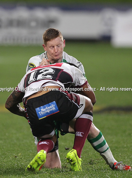 Manawatu`s Hamish Northcott is tackled by by North Harbour`s Pita Ahki in an ITM Cup Rugby Match, North Harbour v Manawatu, QBE Stadium, Auckland, New Zealand, Friday, September 12, 2014. Photo: David Rowland/Photosport