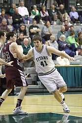 15 December 2012: Parker Musselman makes a move to get around John Steinberg during an NCAA mens division 3 basketball game between theUniversity of Chicago Maroons and the Illinois Wesleyan Titans in Shirk Center, Bloomington IL