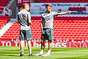 Leeds United midfielder Jamie Shackleton (46) and Leeds United midfielder Alfie McCalmont (38) arrive at the ground during the EFL Sky Bet Championship match between Stoke City and Leeds United at the Bet365 Stadium, Stoke-on-Trent, England on 24 August 2019.