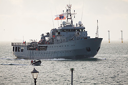 """© Licensed to London News Pictures. 09/01/2017. Portsmouth, UK.  The Polish Navy's youngest ship, ORP Kontradmiral Xawery Czernicki, """"Czernicki"""", sails into Portsmouth Harbour under Police escort this morning, 9th January 2017. The multi-role support ship is visiting Portsmouth before deploying on a 6-month mission to join Standing NATO Maritime Group 2 (SNMG2) in the Mediterranean Sea. Photo credit: Rob Arnold/LNP"""