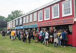 Festival goers queueing at the bar on day 1 of All Points East festival in Victoria Park in London, UK. Picture date: Friday 25 May 2018. Photo credit: Katja Ogrin/ EMPICS Entertainment.