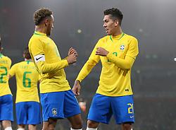 Brazil's Neymar (left) celebrates scoring his sides first goal with Roberto Firminio