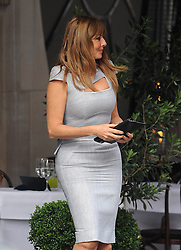 Loose Women presenter Carol Vorderman wearing a grey Victoria Beckham dress enjoys lunch with co-presenter Sally Lindsay at Scott's restaurant in Mayfair. After Lunch the pair said their goodbyes and Carol headed to the Dorchester Hotel in her Chauffeur driven car... 12/09/2012<br />BYLINE MUST READ : GOTCHAIMAGES.COM<br /><br />Copyright by © Gotcha Images Ltd. All rights reserved.<br />Usage of this image is conditional upon the acceptance <br />of Gotcha Images Ltd, terms and conditions available at<br />www.gotchaimages.com