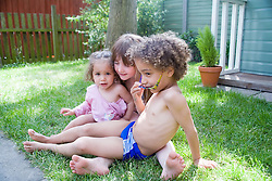 Children playing in the garden together,