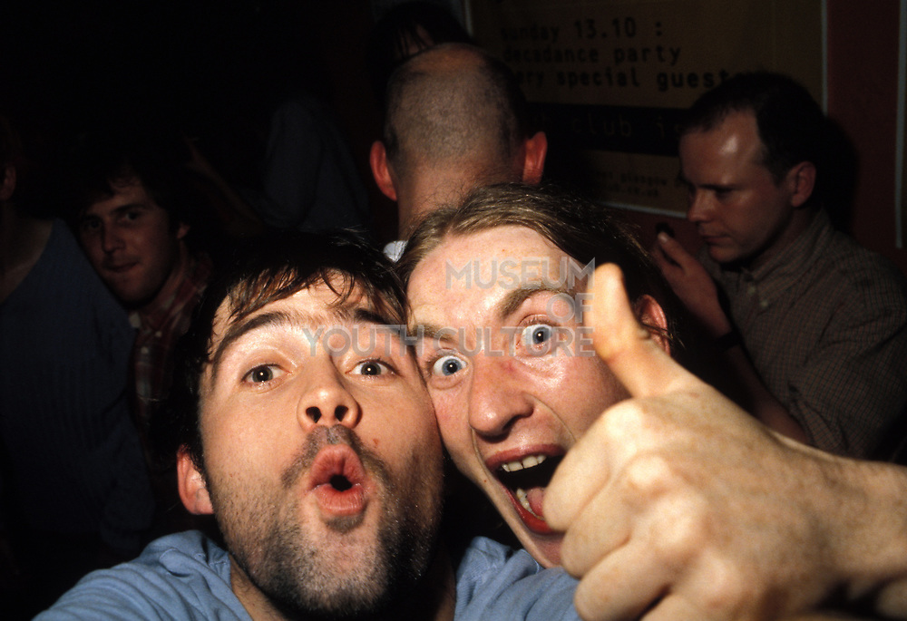 Two men, one with his thumb up at the Sub Club. Glasgow, 1990's