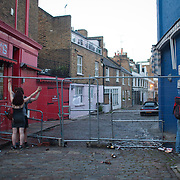 Lovers up against a fence and a man relieves himself in the now empty streets of Portobello.  The Notting Hill Carnival has been running since 1966 and is every year attended by up to a million people. The carnival is a mix of amazing dance parades and street parties with a distinct Caribbean feel.
