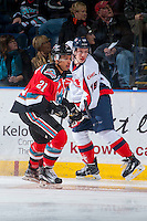 KELOWNA, CANADA - OCTOBER 31: Devante Stephens #21 of Kelowna Rockets checks Brayden Burke #19 of Lethbridge Hurricanes  on October 31, 2015 at Prospera Place in Kelowna, British Columbia, Canada.  (Photo by Marissa Baecker/Shoot the Breeze)  *** Local Caption *** Devante Stephens; Brayden Burke;