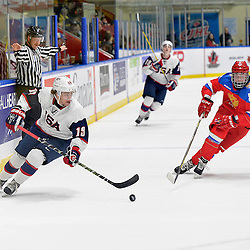 WHITBY, - Dec 17, 2015 -  Game #10 - United States vs. Russia at the 2015 World Junior A Challenge at the Iroquois Park Recreation Complex, ON.  Liam Pecararo #19 of Team United States skates with the puck while being pursued by Ilia Karpukhin #89 of Team Russia during the second period.<br /> (Photo: Shawn Muir / OJHL Images)