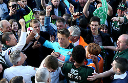 Luke McCormick of Plymouth Argyle is mobbed by fans after clinching a place in the League Two Playoff Final - Mandatory by-line: Robbie Stephenson/JMP - 15/05/2016 - FOOTBALL - Home Park - Plymouth, England - Plymouth Argyle v Portsmouth - Sky Bet League Two play-off semi-final second leg