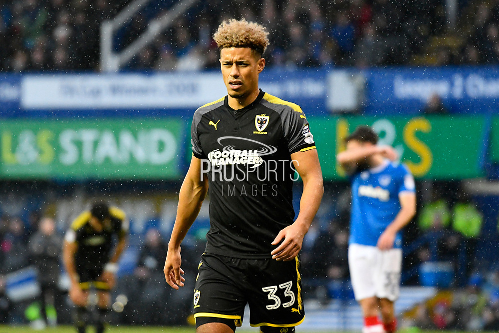 Lyle Taylor (33) of AFC Wimbledon during the EFL Sky Bet League 1 match between Portsmouth and AFC Wimbledon at Fratton Park, Portsmouth, England on 26 December 2017. Photo by Graham Hunt.