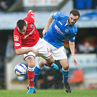 St Johnstone v Ross County....22.11.14   SPFL<br /> Paul Quinn fends off James McFadden<br /> Picture by Graeme Hart.<br /> Copyright Perthshire Picture Agency<br /> Tel: 01738 623350  Mobile: 07990 594431