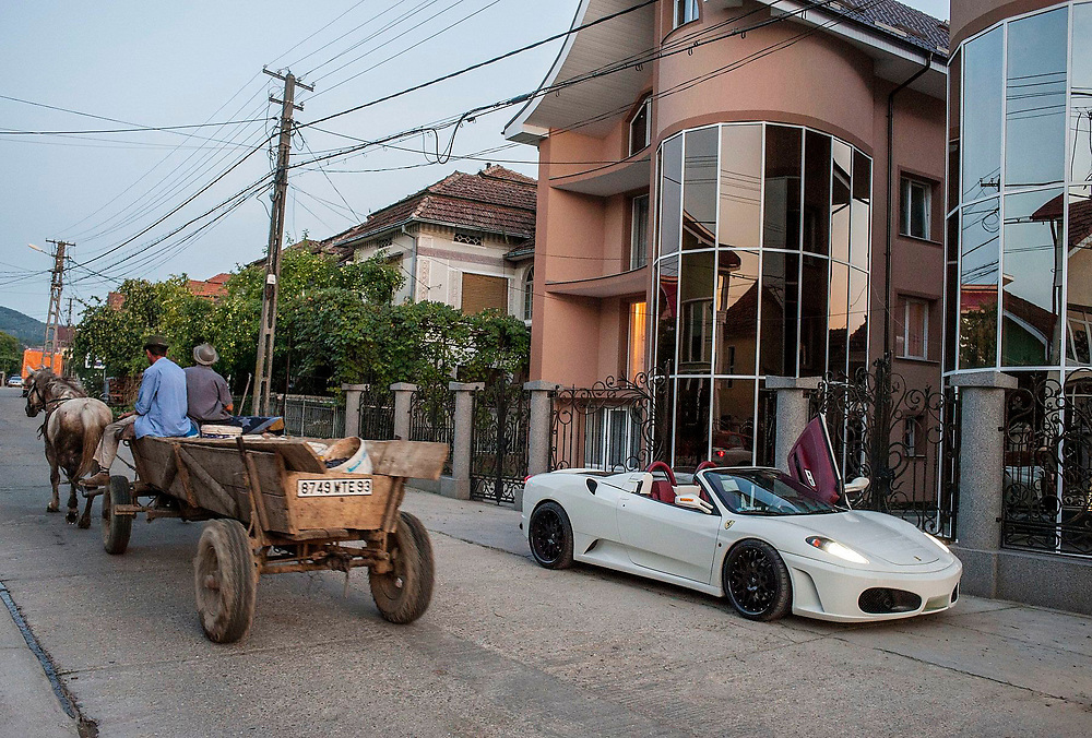 Petre Dorle takes his Ferrari for a spin in the village during the holidays when he visits from France. Petre is a successful entrepreneur who hires Romanian workers to come to France to work in the construction industry.