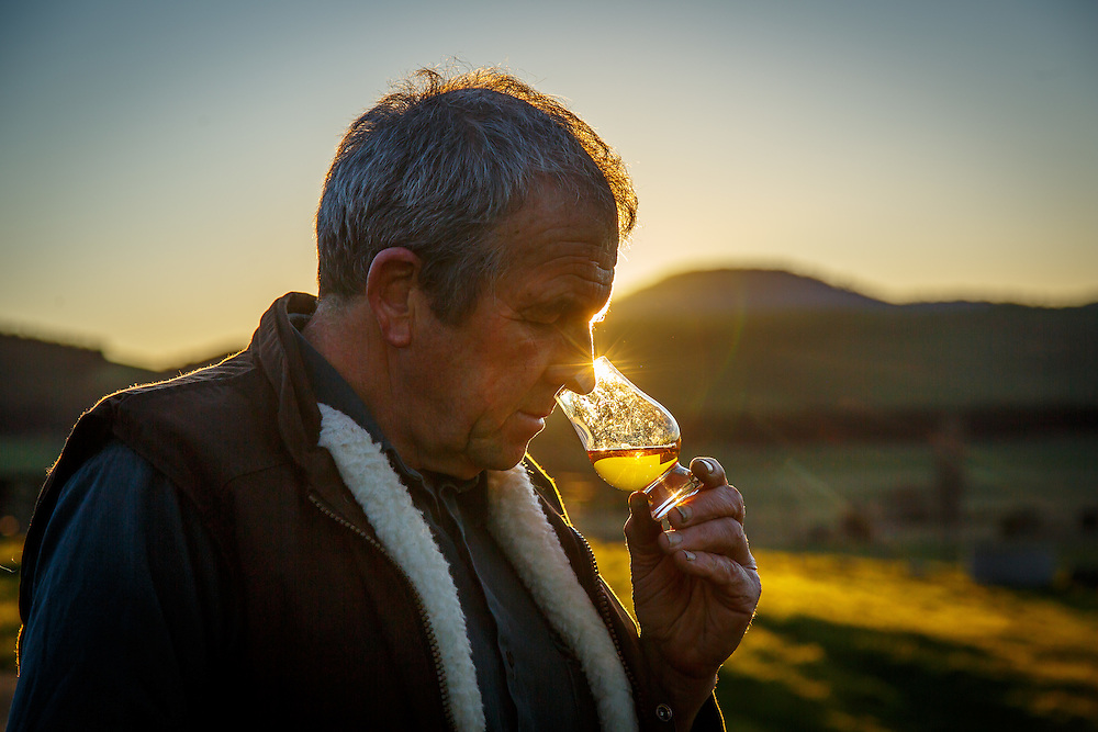 Belgrove Distillery owner Peter Bignell inspects a pour of his whiskey at Belgrove Distillery at sunset in Kempton, Tasmania, August 25, 2015. Gary He/DRAMBOX MEDIA LIBRARY