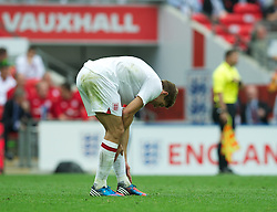 LONDON, ENGLAND - Saturday, June 2, 2012: England's captain Steven Gerrard stretches after picking up an injury during the International Friendly match against Belgium at Wembley. (Pic by David Rawcliffe/Propaganda)