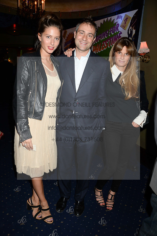 Left to right, JEMIMA JONES, BEN GOLDSMITH and JEMIMA KHAN at the Hoping Foundation's 'Rock On' Benefit Evening for Palestinian refuge children held at the Cafe de Paris, London on 20th June 2013.