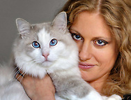 Beautiful young woman holding her cat. Portrait. Close-up.