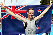 Bevan Docherty (NZL) after winning the silver medal in the Men's Triathlon at the 2006 Commonwealth Games, St Kilda Foreshore, Melbourne, Australia on 18th March 2006. Photo: Sport the Library / www.photosport.nz