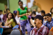 "18 AUGUST 2012 - PHOENIX, AZ: A man listens to immigration lawyers describe the deferred action program at a deferred action workshop in Phoenix. More than 1000 people attended a series of 90 minute workshops in Phoenix Saturday on the ""deferred action"" announced by President Obama in June. Under the plan, young people brought to the US without papers, would under certain circumstances, not be subject to deportation. The plan mirrors some aspects the DREAM Act (acronym for Development, Relief, and Education for Alien Minors), that immigration advocates have sought for years. The workshops were sponsored by No DREAM Deferred Coalition.  PHOTO BY JACK KURTZ"