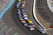 Nov. 12 2011; Avondale, AZ, USA; NASCAR Nationwide Series driver Aric Almirola (88) leads Carl Edwards (60) , Clint Bowyer (33) and the pack during the Wypall 200 at Phoenix International Raceway. Mandatory Credit: Jennifer Stewart-US PRESSWIRE