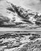 Black and White Mauritius Beach with stormy clouds