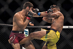 September 16, 2017 - Pittsburgh, Pennsylvania, USA - September 16, 2017: Gilbert Burns and Jason Saggo trade blows during UFC Fight Night at PPG Paints Arena in Pittsburgh, Pennsylvania. (Credit Image: © Scott Taetsch via ZUMA Wire)