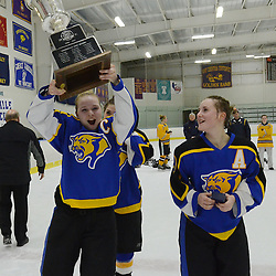 Staff photos by Tom Kelly IV<br /> East's Katie Stueve (19) lifts up the cup following the Downingtown East vs Unionville girls Flyer's Cup Championship, Wednesday night March 19, 2014 at Ice Line in West Goshen.