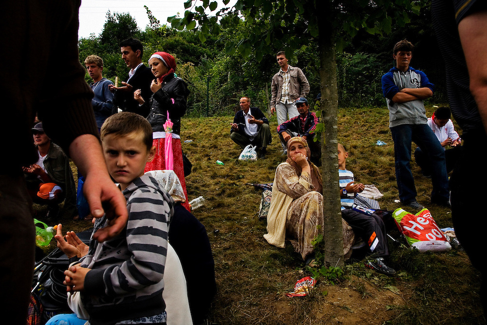 Families of Srebrenica victims gather at the Potocari memorial to bury the remains of their loved ones. July 2009.