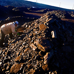 A Navajo man gathers coal at the public load out facility at the Kayenta Mine in Black Mesa. Members of the public often purchase the coal to sell by the side of the road throughout the Navajo Nation.
