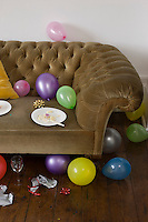 Balloons scattered around sofa
