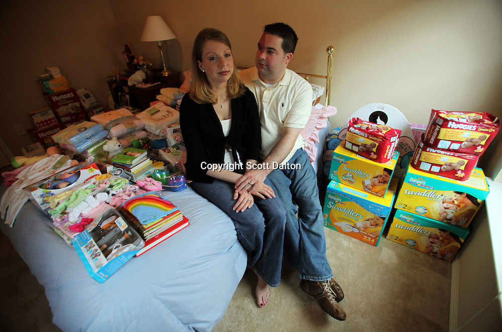 Tom and Amanda Stansel sit in a room full baby items in their home in Houston, TX on Saturday, September 12, 2009. The couple conceived sextuplets via IVF. Amanda carried all six babies to term, but three have since died. (Photo/Scott Dalton)