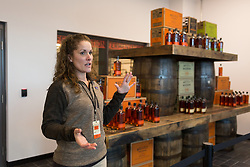 Bulleit employee Nicole Goss gives the media a abbreviated tour at the Bulleit Distilling Co., ribbon cutting with parent company Diageo, Tuesday, March 14, 2017 at Bulleit Distilling Company in Shelbyville.