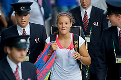 LONDON, ENGLAND - Tuesday, June 30, 2009: Laura Robson (GBR) flanked by security guards as she is escorted back to the players area after her Girls' Singles 2nd Round match on day eight of the Wimbledon Lawn Tennis Championships at the All England Lawn Tennis and Croquet Club. (Pic by David Rawcliffe/Propaganda)