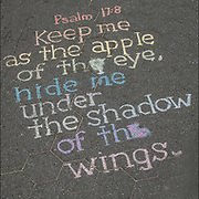 Chalk Street Art quote from Psalm 17:8   &quot;Keep me as the apple of eye. Hid me under the shadow of the wings&quot; on the side walk in Washington Square Park.<br /> <br /> Street art can be a powerful platform for reaching people in public spaces.