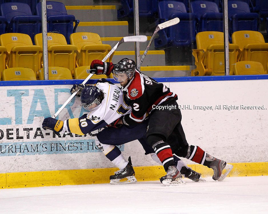 WHITBY, ON - Mar 1 : Ontario Junior Hockey League, Playoff Series  Action,1st round  between, Whitby Fury and the Newmarket Hurricanes. Game three of the series. David Savery #2 of the Newmarket Hurricanes grabs hold of the opposing player Nick Neal #10 of the Whitby Fury during second period game action..(Photo by Tim Bates / OJHL Images)