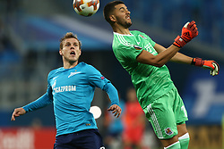 September 28, 2017 - Saint Petersburg, Russia - Aleksandr Kokorin of FC Zenit Saint Petersburg (L) and Gerónimo Rulli of FC Real Sociedad vie for the ball during the UEFA Europa League Group L football match between FC Zenit Saint Petersburg and FC Real Sociedad at Saint Petersburg Stadium on September 28, 2017 in St.Petersburg, Russia. (Credit Image: © Igor Russak/NurPhoto via ZUMA Press)