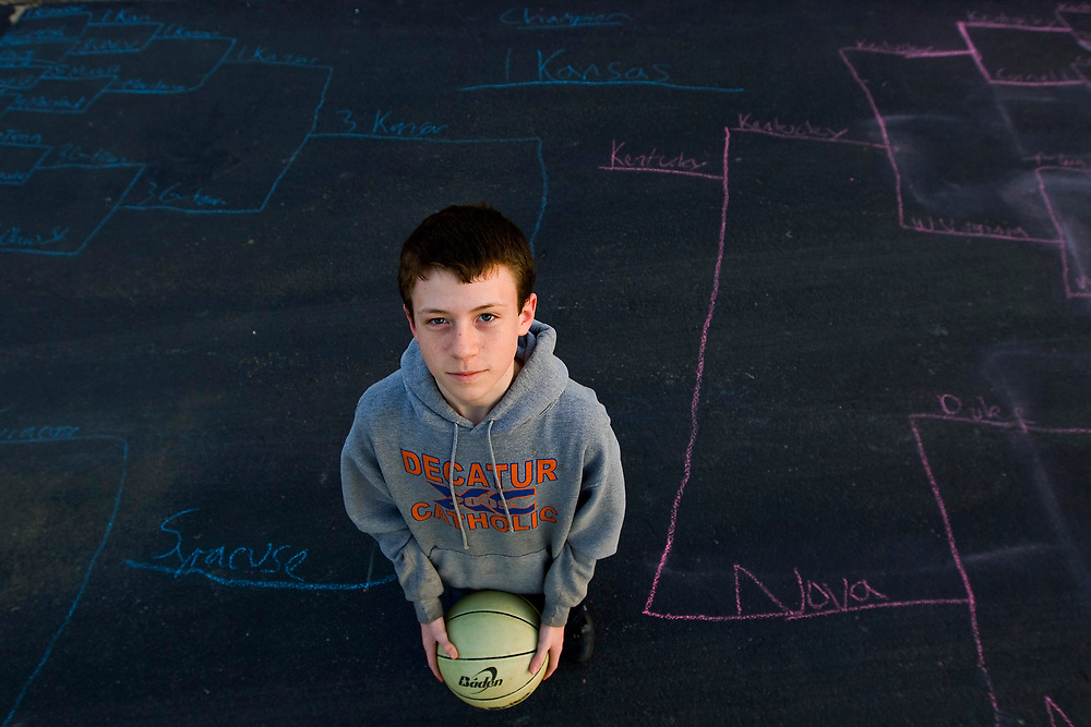 Connor Ginos, 13, stands in the middle of his mother's driveway, Wednesday, March 17, 2010, in Decatur, Ill., where he used sidewalk chalk to draw the NCAA Tournament brackets and filled out his picks. Ginos has Kansas beating Kentucky in the championship game. (Herald & Review/ Stephen Haas)