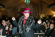 "NEW YORK - DECEMBER 31:  Boy George spins records and announces ""New Years!"" at Ian Schrager's Hudson Hotel December 31, 2003 in New York City.   (Photo by Matthew Peyton)"