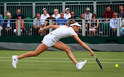 Elise Mertens in acton Barbora Strycova on day seven of the Wimbledon Championships at the All England Lawn Tennis and Croquet Club, Wimbledon.