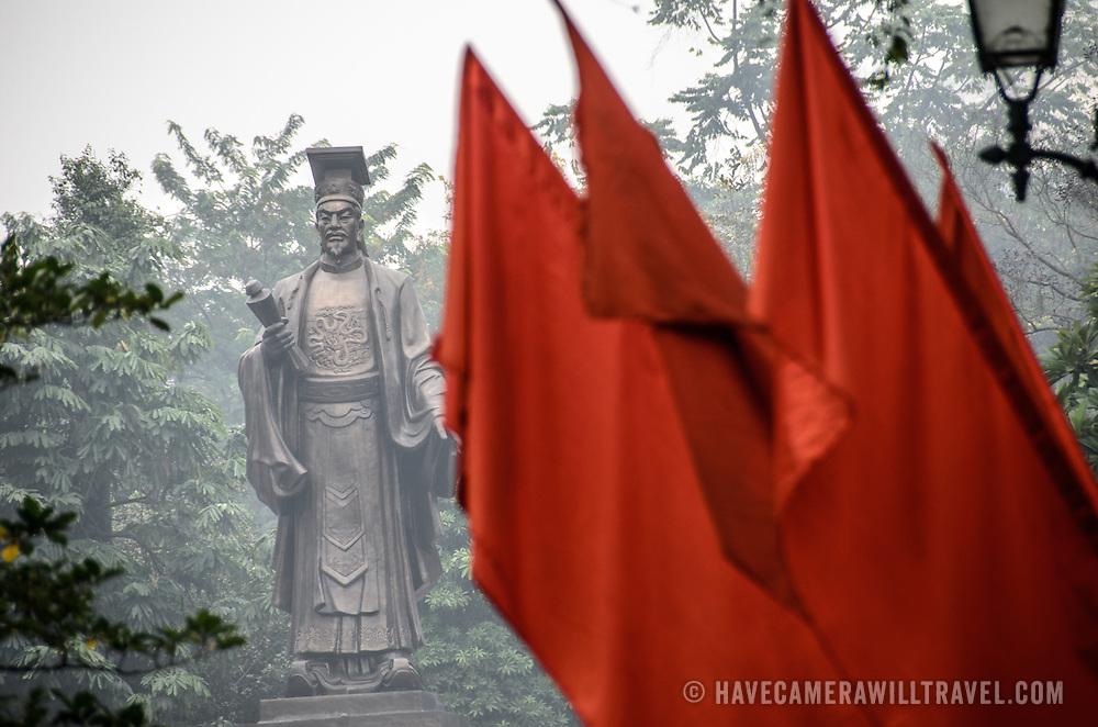Statue of a famous scholar near Hoan Kiem Lake in Hanoi, Vietnam.