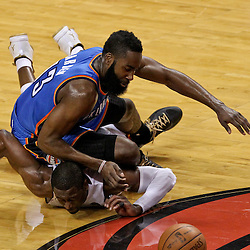 Jun 21, 2012; Miami, FL, USA; Miami Heat shooting guard Dwyane Wade (3) and Oklahoma City Thunder guard James Harden (13) scramble for a loose ball during the second quarter in game five in the 2012 NBA Finals at the American Airlines Arena. Mandatory Credit: Derick E. Hingle-US PRESSWIRE