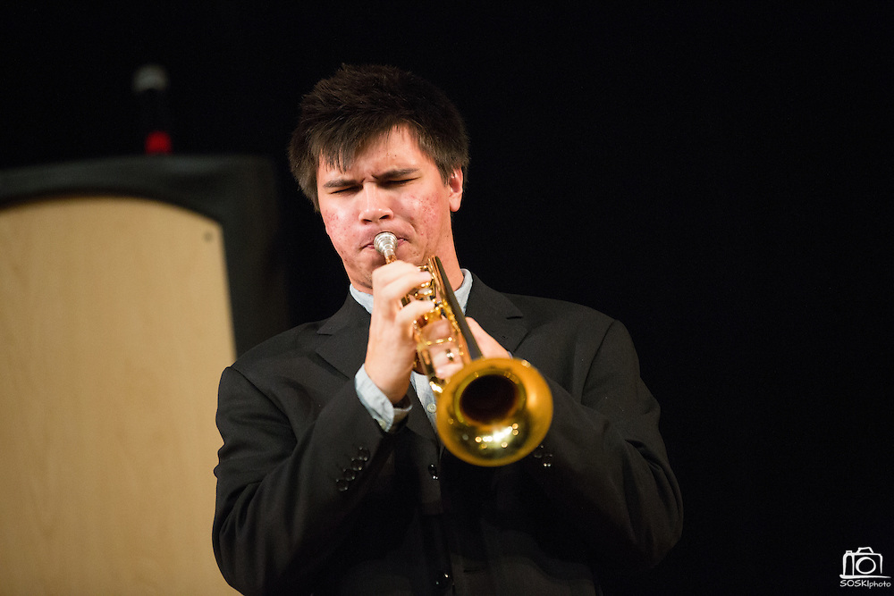 """Nathan Tao of San Jose State University's School of Music and Dance's Thursday Morning Revival plays the trumpet during a performance of """"Bourbon Street Parade"""" during Humanities & Arts Day Student Showcase at San Jose State University's Student Union Barrett Ballroom in San Jose, California, on October 25, 2013. (Stan Olszewski/SOSKIphoto)"""