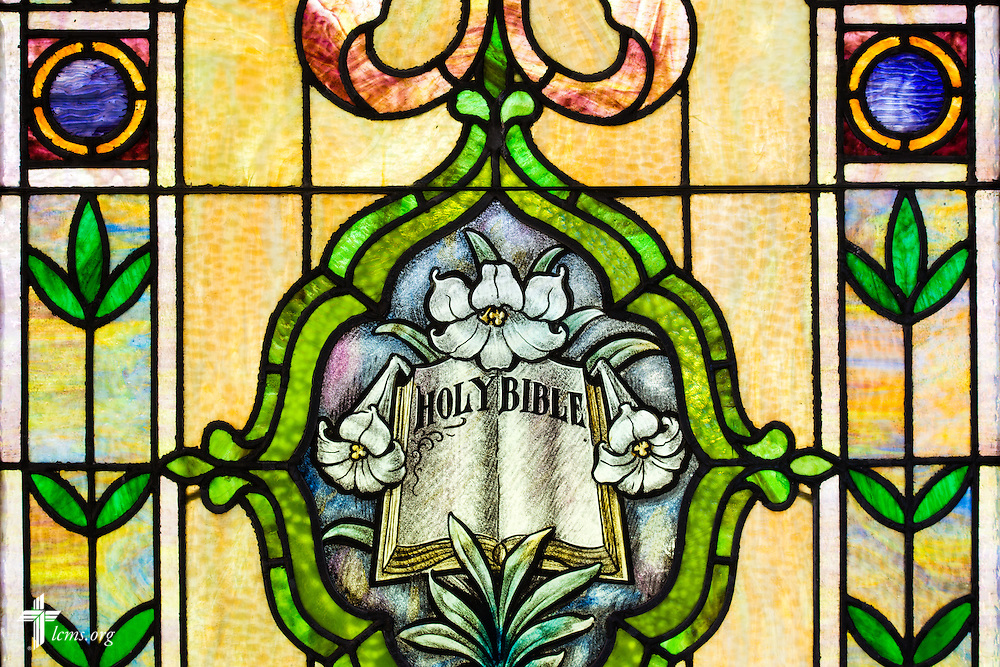 Stained glass depicting the Bible inside the Wayside Prayer Chapel on Sunday, July 19, 2015, at Mission Central in Mapleton, Iowa. LCMS Communications/Erik M. Lunsford