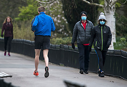 © Licensed to London News Pictures. 03/04/2020. London, UK. Members of the public exercise in Regents Park in London during a pandemic outbreak of the Coronavirus COVID-19 disease. The public have been told they can only leave their homes when absolutely essential, in an attempt to fight the spread of coronavirus COVID-19 disease. Photo credit: Ben Cawthra/LNP