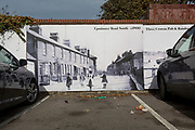 A street scene of children from nearby Upminster playing in an historical photo dated at the turn of the 20th century but reproduced in the car park of the Three Crowns pub, on 8th October 2019, in Rainham, Essex, England. Voters in this Havering borough voted 69% in favour of Brexit during the 2016 referendum.